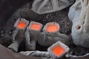 molten bronze cools in several different molds