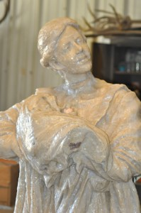 Original clay model of the woman holding a baby covered with silicon to form the mold